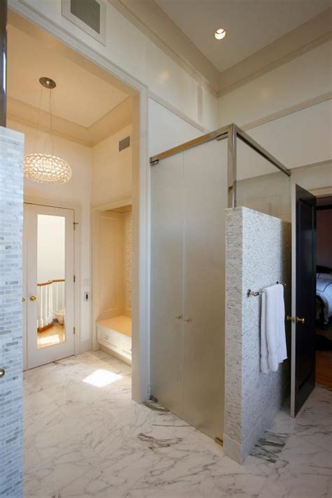 frosted glass doors enclose toilet  master bathroom hgtv