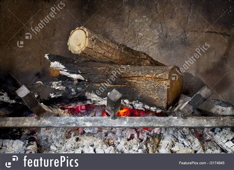 Image Of Fireplace With Burning Wood Logs