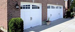 Carriage garage doors settlers collection steel for Carriage style garage doors prices