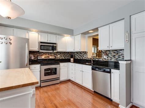 kitchen with hardwood floors sold remodelled town home for in centre ridge 6518