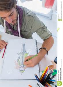designer mode fashion designer drawing a coat royalty free stock photography image 31549417