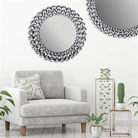 The round glass is surrounded with a steel frame that has a gold finish, but there is a tiny gap between the mirror and frame letting your wall color shine through just a bit. Pinnacle Jeweled Round Silver Decorative Mirror-18FP1410E ...