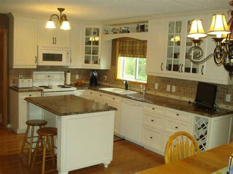 cloud white flat square cabinet  jamocha granite counter  black handles   home