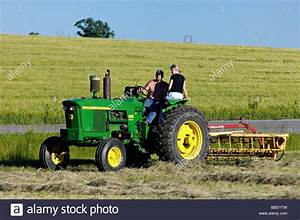 Farmer And His Wife On John Deere 3010 Diesel Tractor In Harrison Stock Photo  24300777