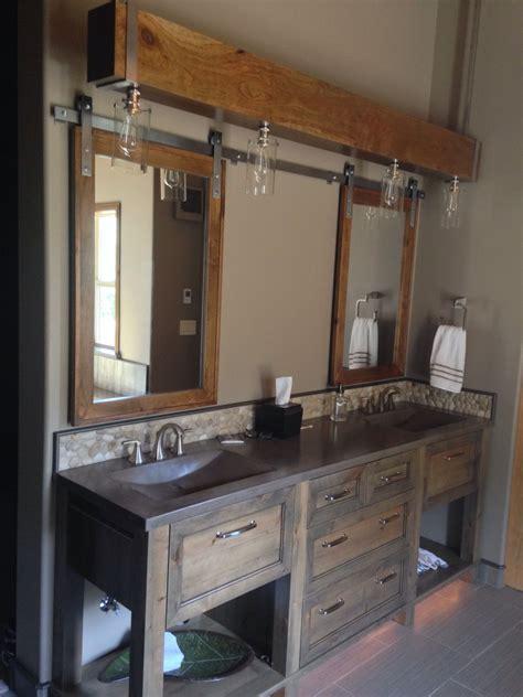 concrete sinks suspended beam lighting barn door medicine cabinets rock backsplash bathroom