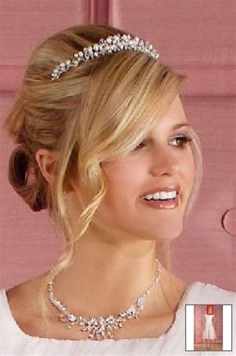 wedding updo hairstyle  tiara hairstyles bun