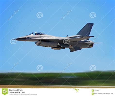 Military Jet Fighter In Flight Stock Image