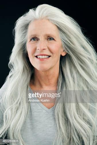 mature woman  wind blown long gray hair stock photo