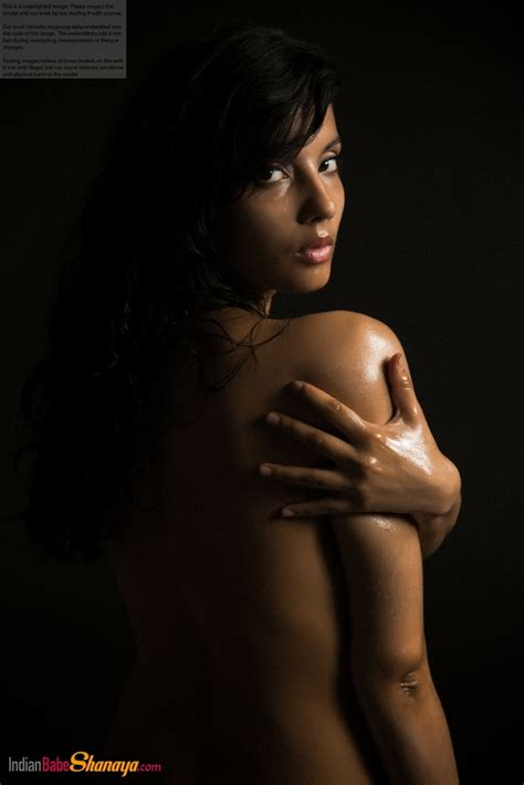 Naked Indian female exposes a single breast while modeling ...