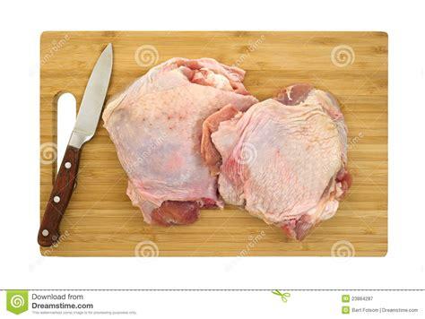 knife  turkey thighs  cutting board royalty