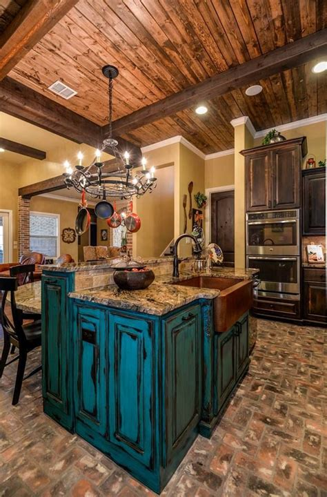 tuscan design turquoise distressed island  granite counter tops brick flooring knotty