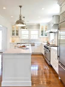 kitchen island with sink and dishwasher and seating white kitchen cabinets with stainless steel appliances