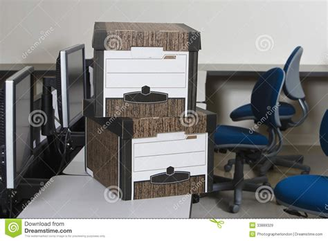 moving boxes and chairs in office royalty free stock