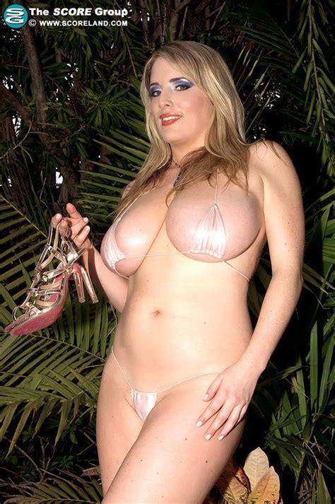 Busty Milf Maggie Green Strips Off Her White Micro Bikini