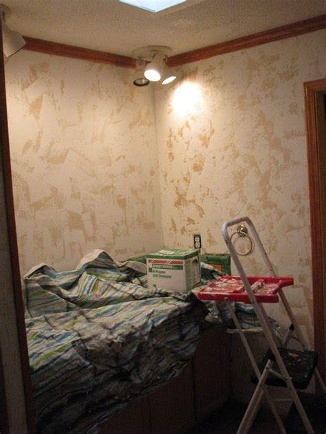 hand plaster walls  cover wallpaper  damage