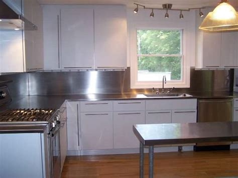 white kitchen with stainless steel backsplash 4 finish counter top with high backsplash and integrated sink 2106