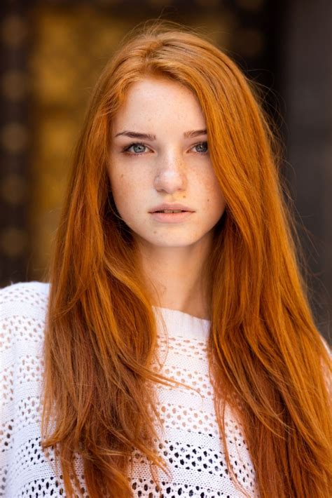 photographer travels the world to capture the exceptional beauty of redheaded women