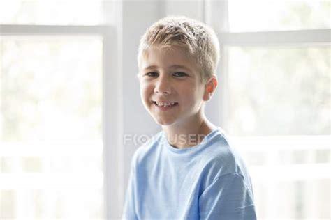 portrait  preteen boy smiling    camera