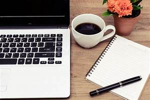 Laptop, And, Cup, Of, Coffee, With, Flower, On, Desk, Stock, Image