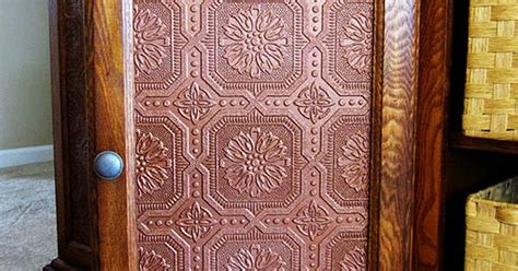 faux tin panels to replace glass cabinet doors may
