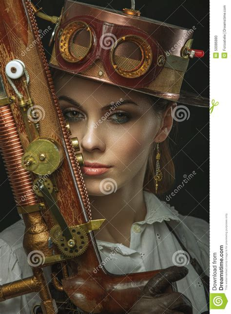 close  portrait  steampunk girl   gun   hand