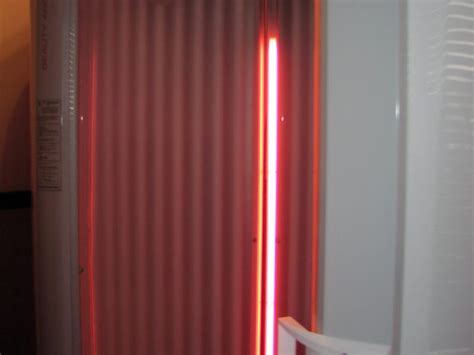 red light therapy bed planet fitness planet fitness expands tanning area adds red light