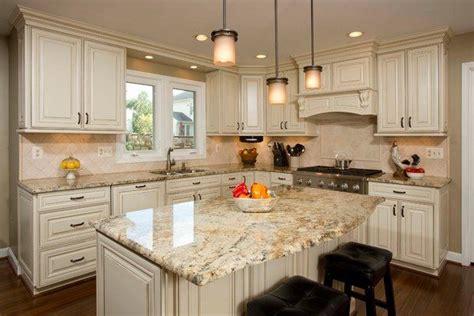 white kitchen cabinets yellow river granite countertops