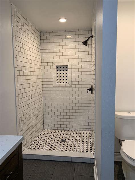 master bath shower white tiles black grout master