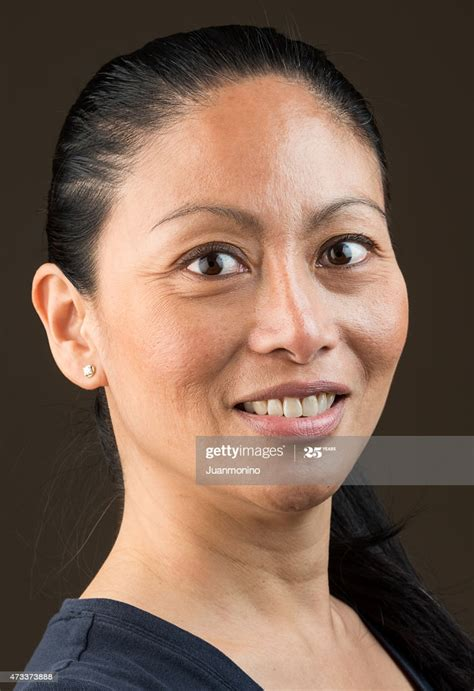 Mature Asian Woman High-Res Stock Photo - Getty Images