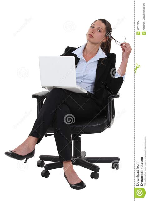 confident businesswoman sitting cross legged stock images