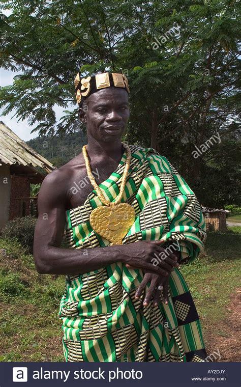 African chief in his village dressed in ceremonial regalia ...