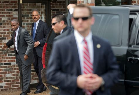 eric holder visits ferguson talks    angry