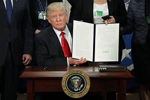 Trump signs executive order to end federal funding of ...