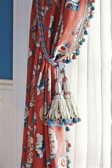 blue and white curtains with tassel fringe window
