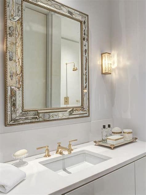 white  gold bathroom features  antiqued mirror