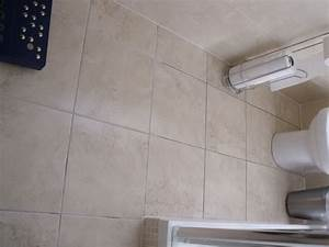 Tile floor in small bathroom needs re grouting tiling for Small bathroom big or small tiles