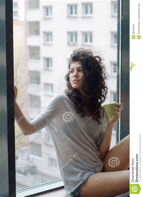 Thoughtful Woman In The City Apartment Royalty Free Stock