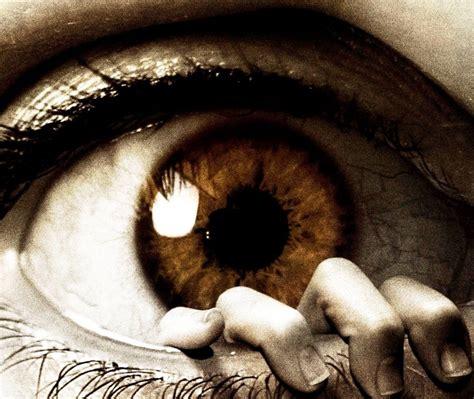 eye fear horror hand fingers eye eyelashes