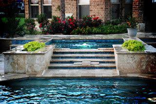 travertine raised spa contemporary pool dallas