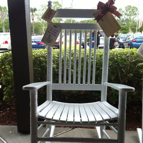 white wooden rocker from cracker barrel outdoor decor