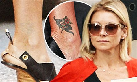 kelly ripa    removing ankle tattoo
