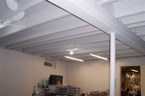 spray painting on plastic drop how to paint a basement ceiling with exposed joists for an