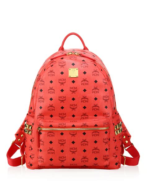 mcm stark side studded coated canvas monogram backpack  bright red red  men lyst