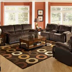 spacious living room design with red wall color and brown leather sofa decoration get the most