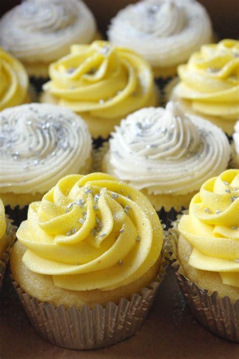 yellow  white icing  vanilla cupcakes