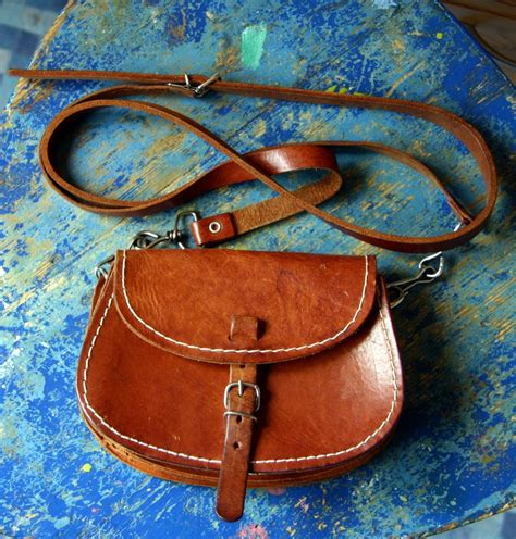 small vintage brown leather mini saddle bag purse