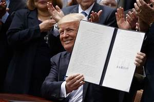 Trump signs order to ease ban on political activity by ...