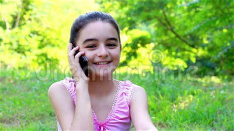 Smiling Preeteen Girl Talking On Smart Phone Stock Video