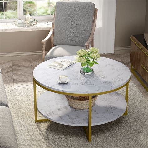 This asymmetrical table is a great option—and the top rotates out. Tribesigns Round Coffee Table, Modern Accent Table 2-Tier Open Storage Shelf Marble Style with ...