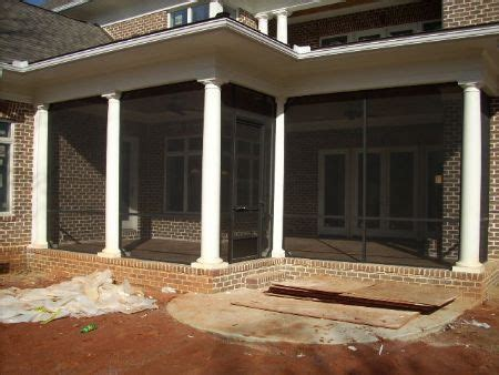 screened  porch  brick columns bronze framing